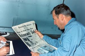 Jim Lovell Reads Newspaper after their Return