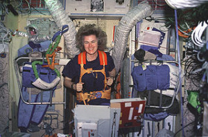 Shannon Lucid working out on a treadmill aboard Mir